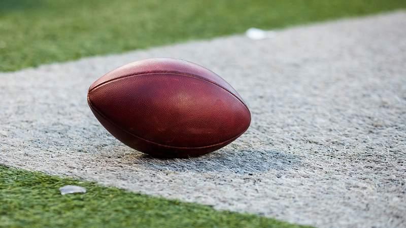 Football generic ball on football field generic (Photo by Brett Carlsen/Getty Images)