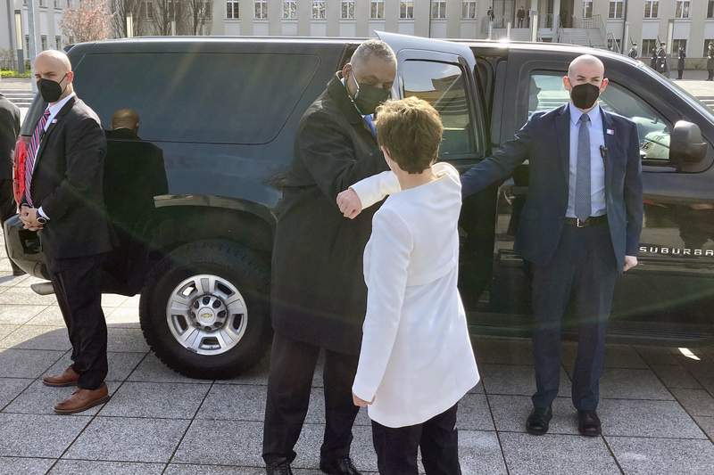U.S. Defense Secretary Lloyd Austin is greeted by German Defense Minister Annegret Kano-Karrenbauer, Tuesday, April 13, 2021, in Berlin. (AP Photos/Robert Burns)