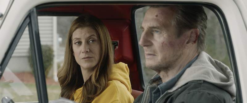 """This image released by Open Road Films shows Kate Walsh, left, and Liam Neeson in a scene from """"Honest Thief."""" (Open Road Films via AP)"""