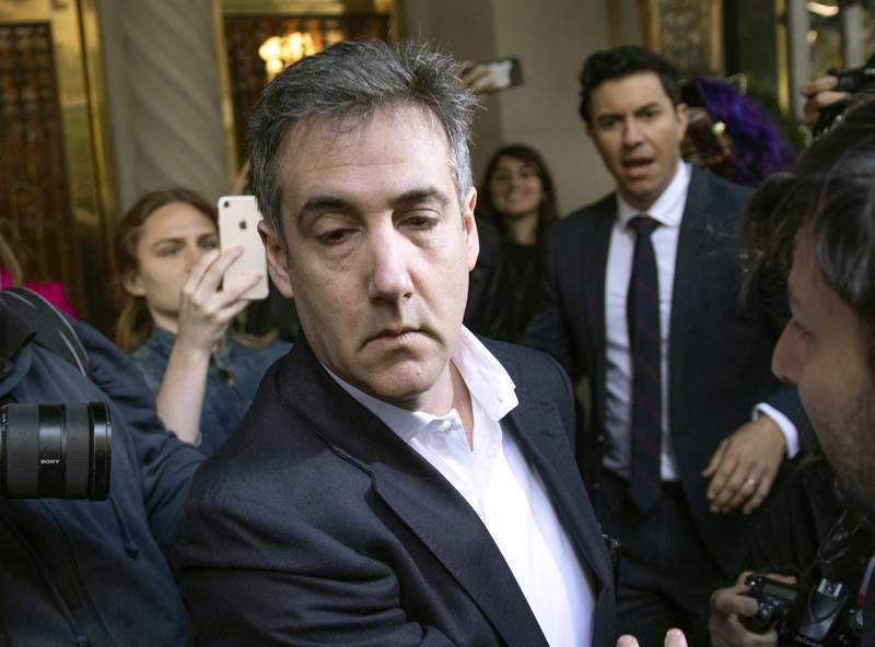 FILE - In this May 6, 2019, file photo, Michael Cohen, former attorney to President Donald Trump, leaves his apartment building before beginning his prison term in New York. President Trumps former lawyer and longtime fixer Cohen will be released from federal prison to serve the remainder of his sentence in home confinement amid the coronavirus pandemic, a person familiar with the matter told The Associated Press. (AP Photo/Kevin Hagen, File)