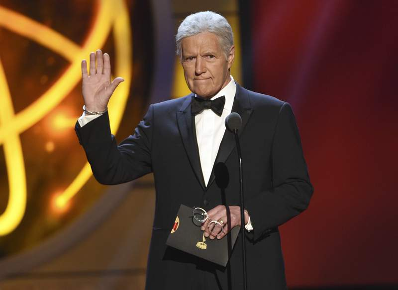 FILE - This May 5, 2019 file photo shows Alex Trebek presenting an award at the 46th annual Daytime Emmy Awards in Pasadena, Calif. The Jeopardy! veteran host's nomination for best game show host could give him for a second consecutive win in the category. (Photo by Chris Pizzello/Invision/AP, File)