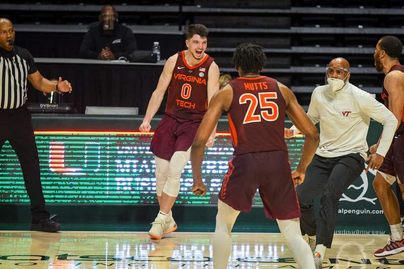 Hunter Cattoor hits the game-tying three pointer to force overtime against Miami