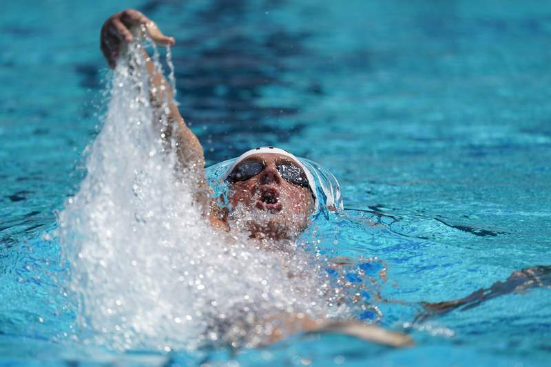 FILE  In this July 31, 2019, file photo, Ryan Lochte competes in the men's 200-meter individual medley time trial at the U.S. national swimming championships in Stanford, Calif. Lochte was ticked off about his performances in the pool at the U.S. Open, the first major meet on American soil since the coronavirus pandemic shut down sports in mid-March. Lochte finished third in the 200-meter individual medley with a time 2 minutes, 1.05 seconds Friday  well behind winner Chase Kalisz in 1:59.72. (AP Photo/David J. Phillip, File)