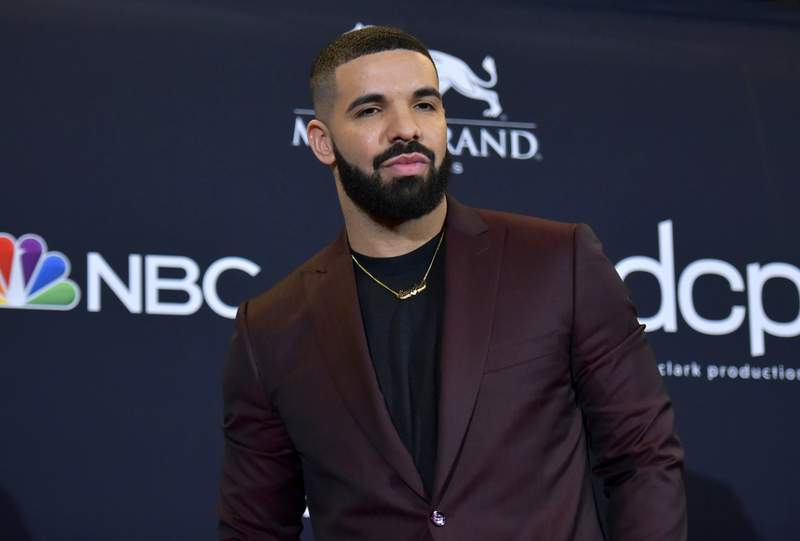 """FILE - This May 1, 2019 file photo shows Drake at the Billboard Music Awards in Las Vegas. Earning his 21st No. 1 hit on Billboard's R&B/Hip-Hop songs chart, Drake has bested a record previously held by icons Aretha Franklin and Stevie Wonder. Drake's Laugh Now Cry Later,"""" featuring rapper Lil Durk, reached the No. 1 spot on the chart this week. Wonder and Franklin, who died in 2018, each have had 20 songs top the chart. (Photo by Richard Shotwell/Invision/AP, File)"""