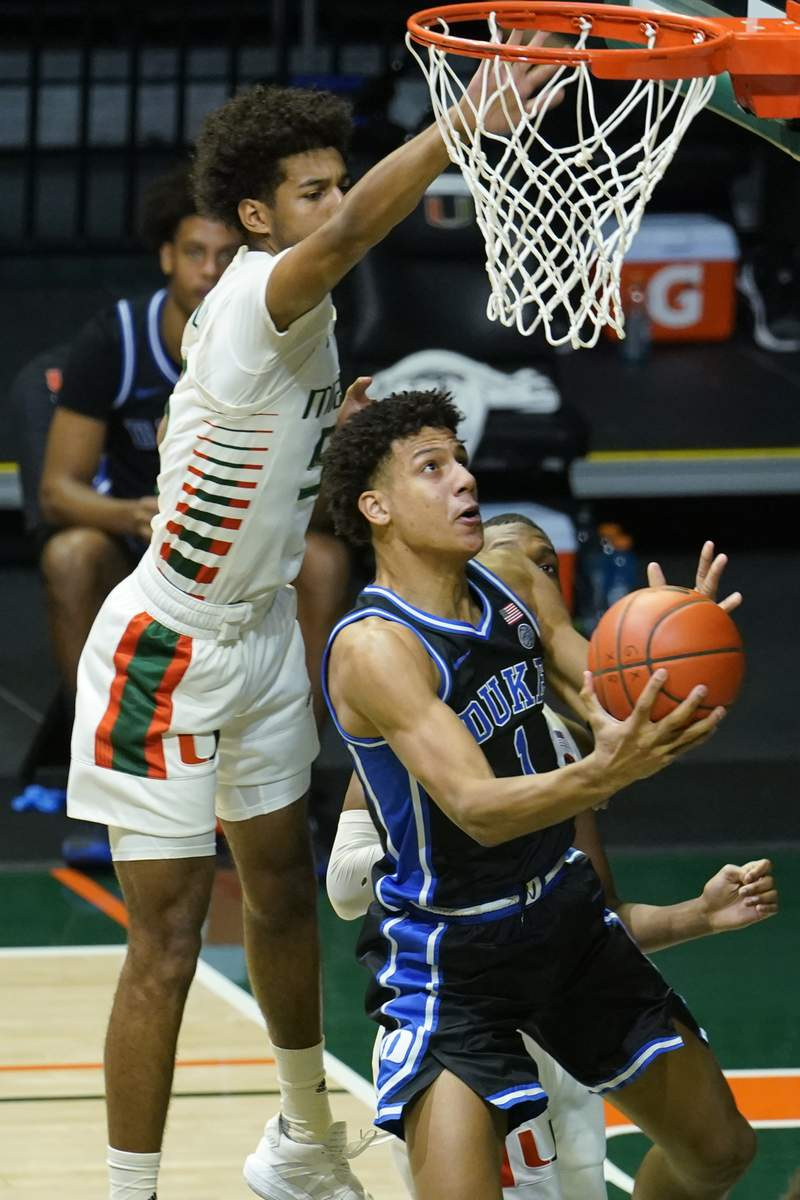 Duke forward Jalen Johnson (1) drives to the basket as Miami guard Harlond Beverly (5) defends during the second half of an NCAA college basketball game, Monday, Feb. 1, 2021, in Coral Gables, Fla. (AP Photo/Marta Lavandier)
