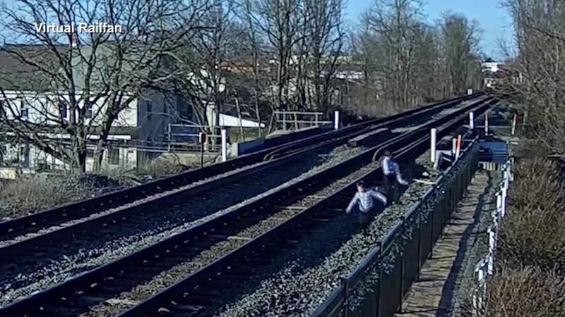 Caught on camera: Pennsylvania family nearly hit by train