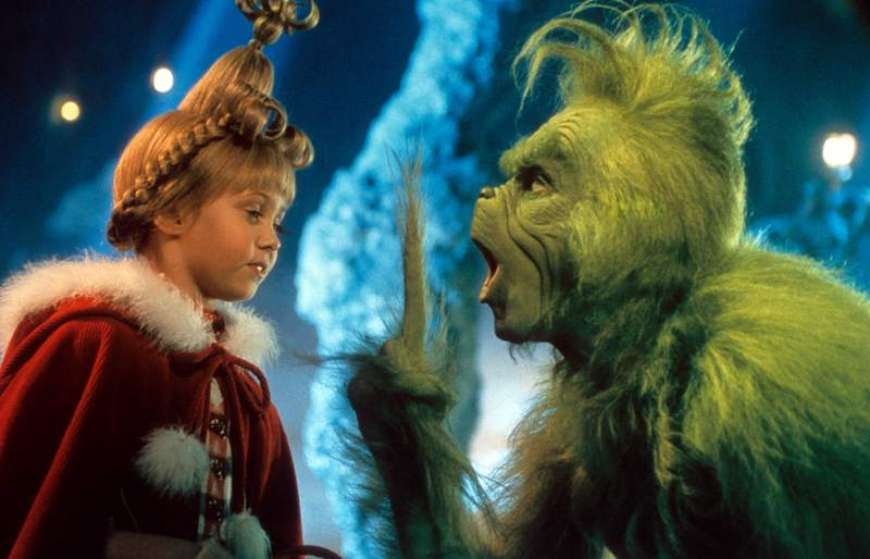Taylor Momsen listening to Jim Carrey in a scene from the film 'How The Grinch Stole Christmas', 2000. (Photo by Universal/Getty Images)