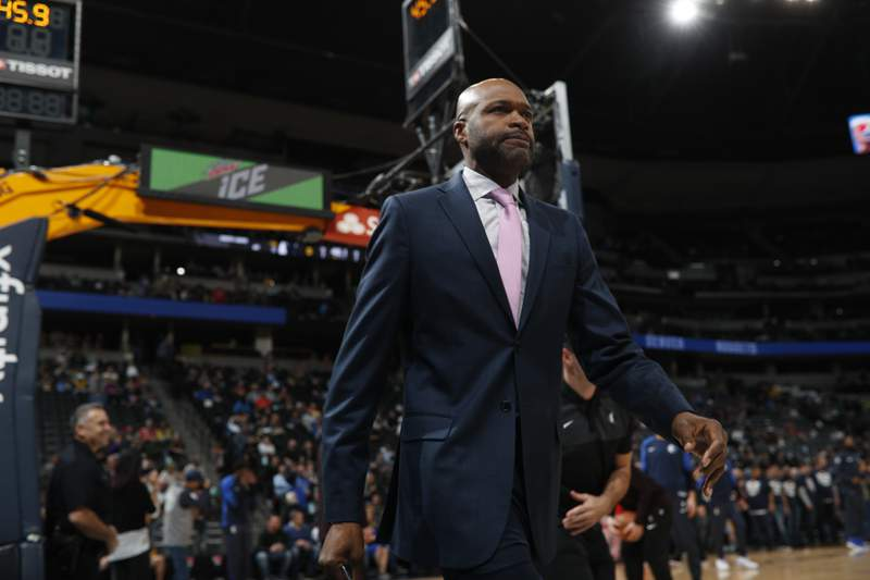 Dallas Mavericks assistant coach Jamahl Mosley in the first half of an NBA basketball game Tuesday, Dec. 18, 2018, in Denver. The Orlando Magic finalized a deal Sunday, July 11, 2021 to make Mosley the 14th coach in franchise history. (AP Photo/David Zalubowski)