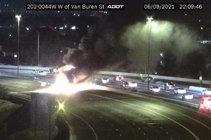 This image from an Arizona Department of Transportation remote traffic camera shows the scene of a crash involving a milk tanker truck in Phoenix on Wednesday, June 9, 2021. Authorities say the milk tanker truck going too fast for traffic conditions collided with seven other vehicles on a freeway.  (Arizona Department of Transportation via AP).