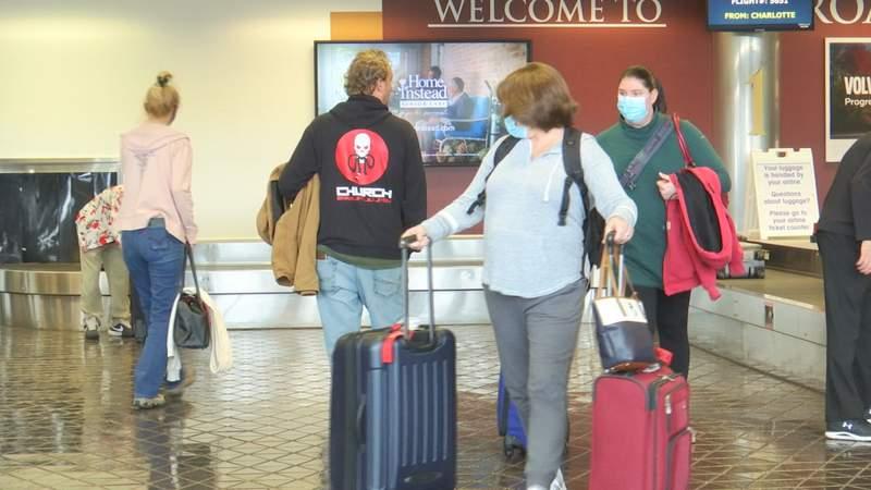Air travelers pick up their luggage at Roanoke-Blacksburg Regional Airport baggage claim.