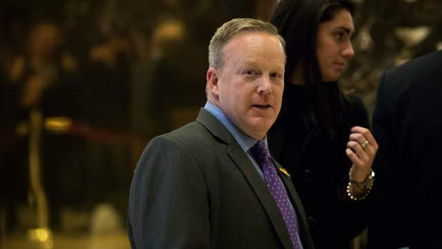 Republican National Committee communications director Sean Spicer walks through the lobby at Trump Tower, December 14, 2016 in New York City. (Photo by Drew Angerer/Getty Images)