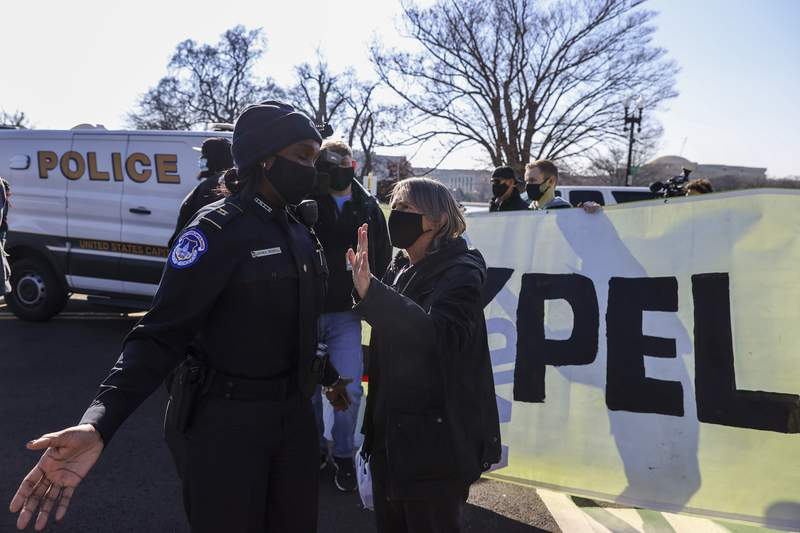 Capitol police and anti-Trump protesters gather on the West Front of the U.S. Capitol on Jan. 13, 2021 in Washington, D.C.
