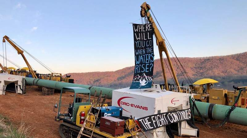 Protester chains herself to construction equipment along Mountain Valley Pipeline