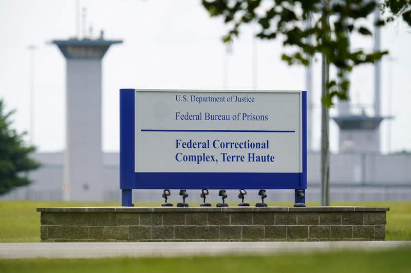 FILE - This Aug. 28, 2020, file photo shows the federal prison complex in Terre Haute, Ind.   (AP Photo/Michael Conroy, File)A federal judge said the Justice Department unlawfully rescheduled the execution of the only woman on federal death row, potentially setting up the Trump administration to schedule the execution after president-elect Joe Biden takes office. U.S. District Court Judge Randolph Moss also vacated an order from the director of the Bureau of Prisons that had set Lisa Montgomerys execution date for Jan. 12, 2021.  (AP Photo/Michael Conroy)