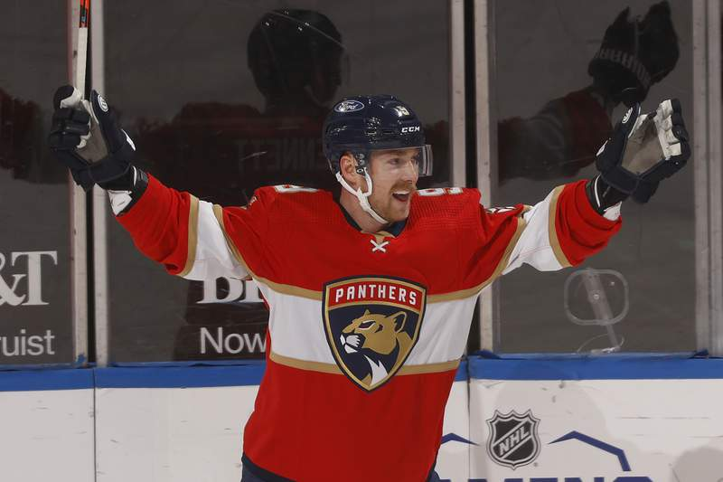 FILE - Florida Panthers center Sam Bennett (9) celebrates after scoring a goal against the Blue Jackets during the first period of an NHL hockey game in Sunrise, Fla., in this Tuesday, April 20, 2021, file photo. Sam Bennett re-signed with the Florida Panthers on Monday, July 26, 2021, inking a four-year contract with the team that has been a good fit for him since joining at the trade deadline. (AP Photo/Joel Auerbach, FIle)