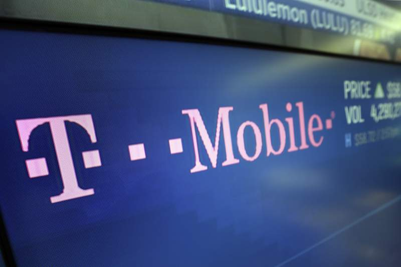 In this Feb. 14, 2018, photo, the logo for T-Mobile appears on a screen at the Nasdaq MarketSite in New York. T-Mobile, one of the three largest mobile carriers in the U.S., said it's working to fix a widespread network issue. The company's president of technology, Neville Ray, tweeted Monday afternoon, June 15, 2020, at around 4 p.m. Eastern Daylight Time that T-Mobile engineers hope to fix the voice and data issue soon. (AP Photo/Richard Drew)