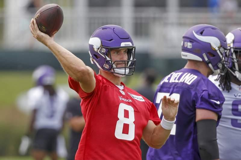 Minnesota Vikings quarterback Kirk Cousins throws during NFL football training camp Wednesday, July 28, 2021, in Eagan, Minn. (AP Photo/Bruce Kluckhohn)