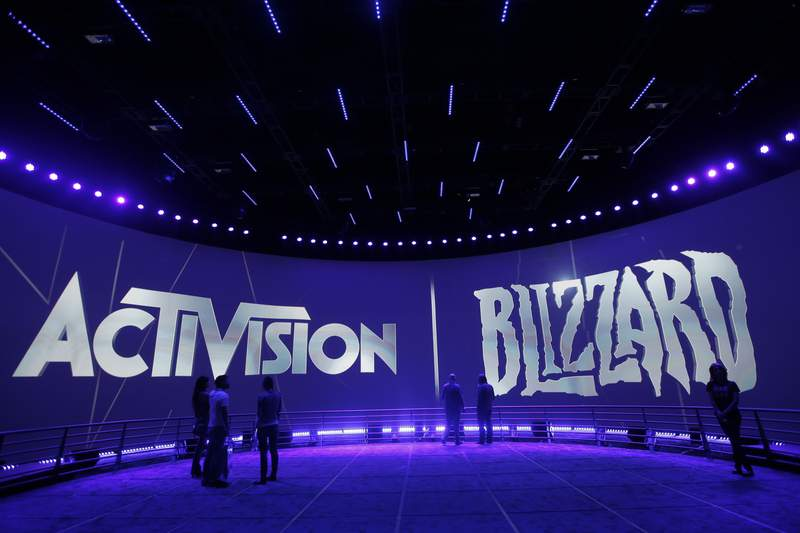 FILE - This June 13, 2013 file photo shows the Activision Blizzard Booth during the Electronic Entertainment Expo in Los Angeles.  Activision Blizzard, the high-profile video game maker facing growing legal problems stemming from allegations of a toxic workplace culture, has settled with U.S. workplace discrimination regulators. The company reached a deal with the U.S. Equal Employment Opportunity Commission to settle claims of sexual harassment, pregnancy discrimination and retaliation against employees who spoke out, according to court documents filed Monday, Sept. 27, 2021.  (AP Photo/Jae C. Hong, File)