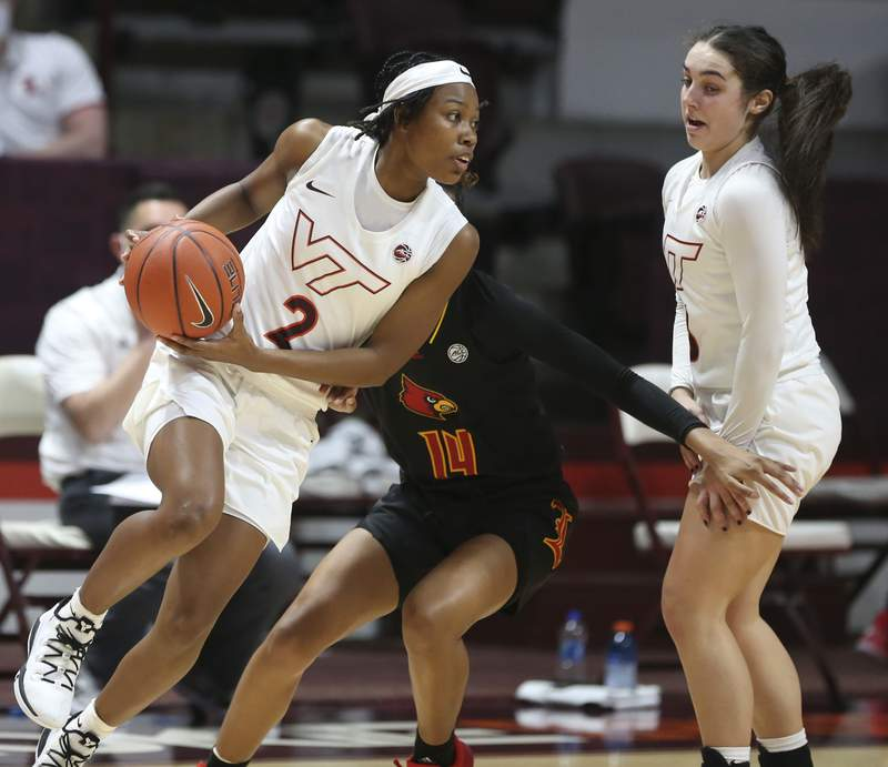Virginia Tech's Aisha Sheppard 2 drives past LouisvilleÕs  Kianna Smith 14 in the first half of an NCAA college basketball game in Blacksburg, Va., Thursday January 7 2021. (Matt Gentry/The Roanoke Times via AP, Pool)