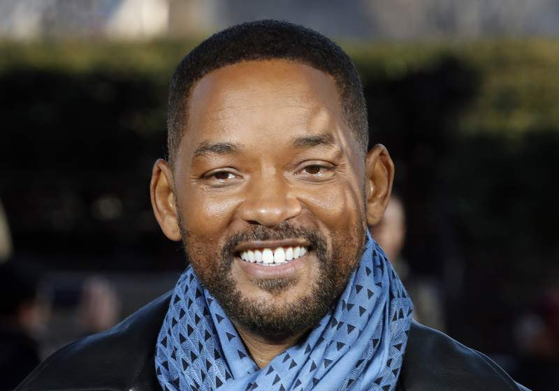 "FILE - In this Monday, Jan. 6, 2020, file photo, U.S actor Will Smith poses for photographers during the photo call of ""Bad Boys for Life,"" in Paris. Smith says he was humbled and honored after rapper Joyner Lucas released a tribute song honoring his career work. Lucas released the music video for his track Will, on Monday, March 23, 2020. (AP Photo/Thibault Camus, File)"