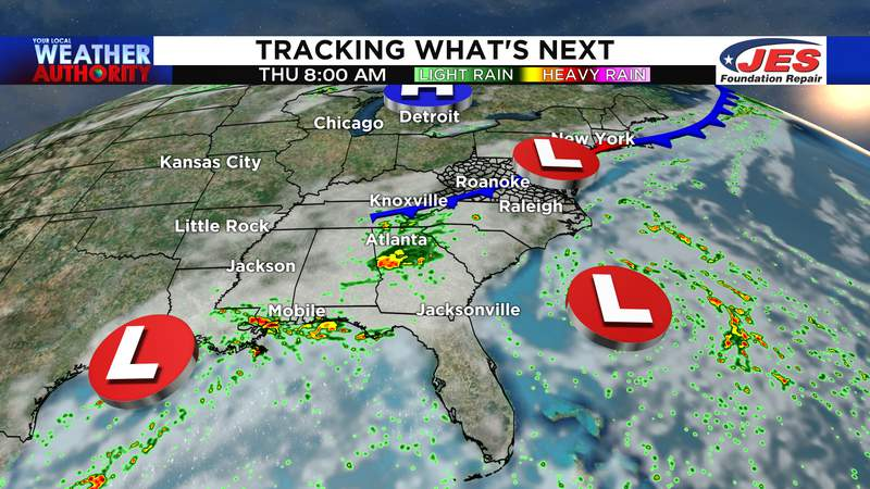 Two tropical lows and a front bring scattered downpours