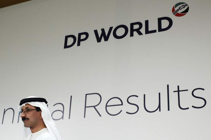 FILE - In this March 15, 2018, file photo, Sultan Ahmed bin Sulayem, DP Worlds chairman and CEO, walks off stage after a news conference in Dubai, United Arab Emirates. Dubai-based port operator DP World announced Thursday, March 18, 2021 its profits slid 29% in 2020 from the previous year to $846 million, as the coronavirus pandemic froze supply chains and upended the worlds trade flows. (AP Photo/Jon Gambrell, File)