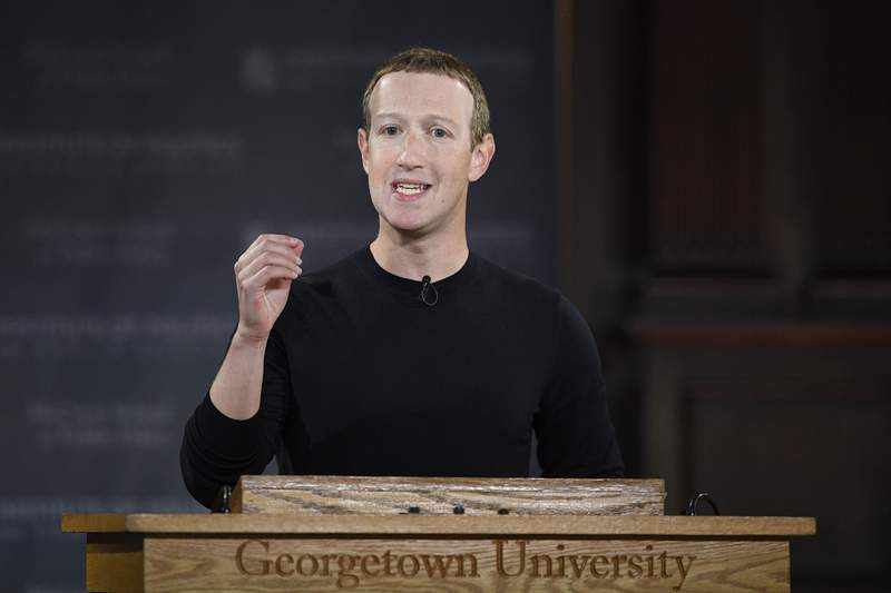 FILE - In this Oct. 17, 2019, file photo, Facebook CEO Mark Zuckerberg speaks at Georgetown University in Washington. Zuckerberg isn't budging over his refusal to take action on inflammatory posts by President Donald Trump that spread misinformation about voting by mail and, many said, encouraged violence against protesters. (AP Photo/Nick Wass, File)