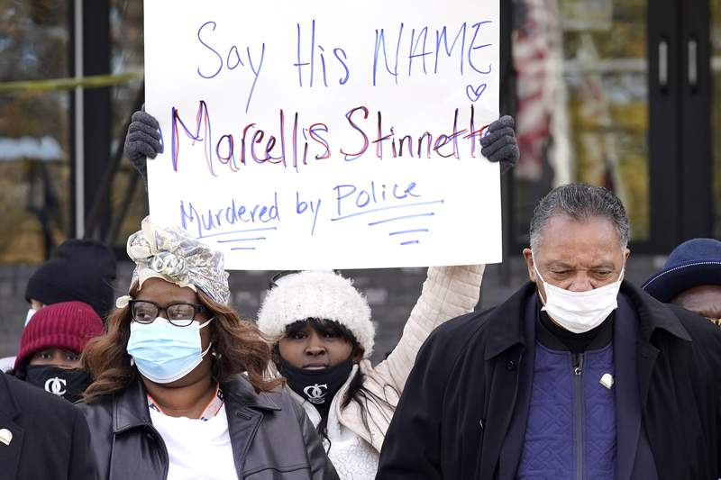 Marcellis Stinnette's mother Zharvellis Holmes, left, her daughter Zhanellis Banks, center, and Rev. Jesse L. Jackson Sr., walk to press conference, Wednesday, Oct. 28, 2020, in Des Plaines, Ill., after viewing the videos of the Oct. 20, 2020 police involved shooting in Waukegan that killed 19-year-old Marcellis Stinnette and seriously wounded Tafara Williams. (AP Photo/Nam Y. Huh)