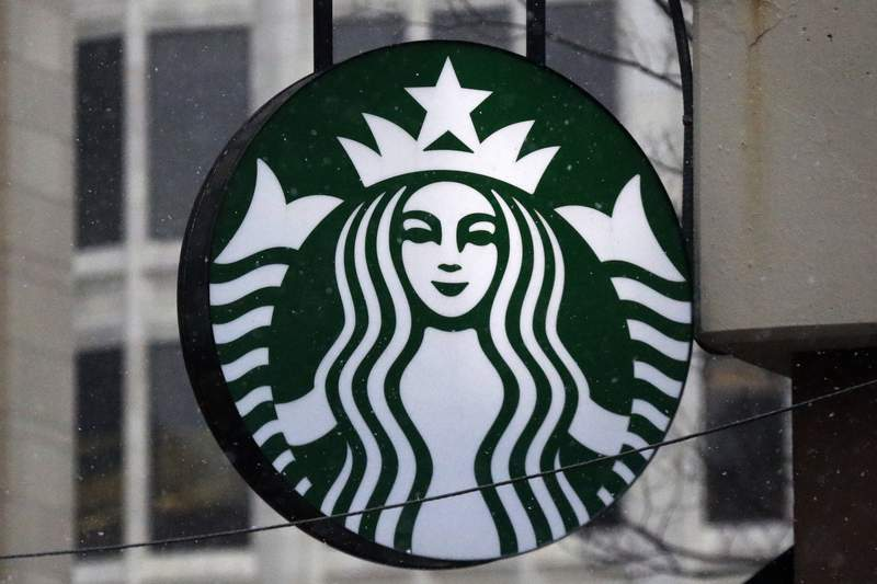FILE - This Tuesday, March 14, 2017, file photo show the Starbucks logo on a shop in downtown Pittsburgh. Starbucks saw record sales in its fiscal third quarter as the impact of the pandemic receded and customers flocked to its stores. The Seattle-based coffee giant said its revenue soared 78% to $7.5 billion in the April-June 2021, period, an all-time high. (AP Photo/Gene J. Puskar, File)