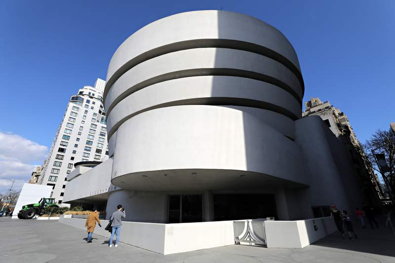 Tourists react to seeing a closed sign outside of Solomon R. Guggenheim Museum of Art on March 13, 2020 in New York City.