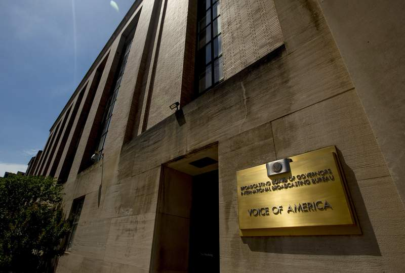FILE - In this June 15, 2020, file photo, the Voice of America building stands in Washington. A federal judge has ruled against the head of the agency that runs the Voice of America and other U.S.-funded news outlets who was accused of trying to turn it into a propaganda vehicle to promote President Donald Trumps agenda. (AP Photo/Andrew Harnik, File)