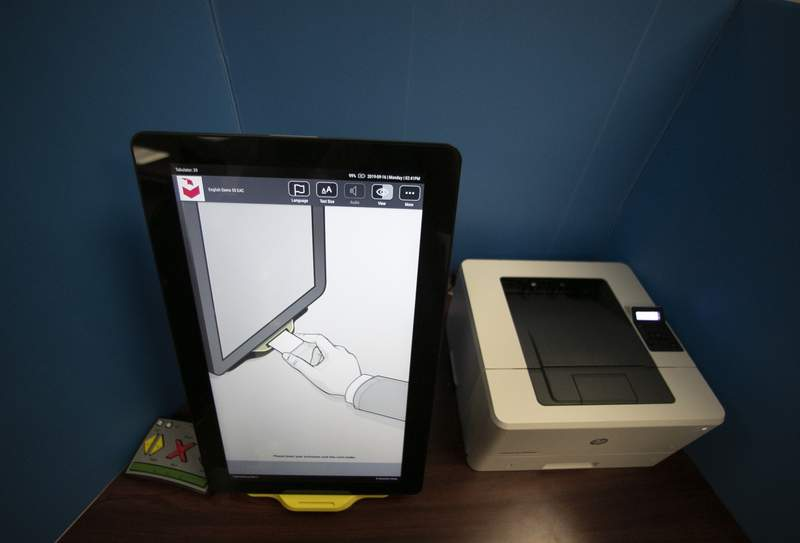 FILE- In this Sept. 16, 2019, file photo, a Dominion Voting Systems voting machine is seen in Atlanta. Dominion Voting Systems is filing a $1.6 billion defamation lawsuit against Fox News, arguing the cable news giant falsely claimed in an effort to boost faltering ratings that the voting company rigged the 2020 election, according to a copy of the lawsuit obtained by The Associated Press (AP Photo/John Bazemore, File)