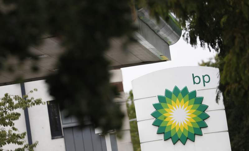 FILE - In this file photo dated Tuesday, Aug. 4, 2020, the logo of British Petroleum, BP, adorns a petrol station in west London.  The London-based oil company, BP said Tuesday Oct, 27, 2020, that third-quarter earnings plunged 96% as the COVID-19 pandemic reduced energy prices and demand.  (AP Photo/Alastair Grant, FILE)