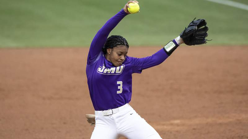 James Madison's Odicci Alexander (3) pitches during an NCAA softball game on Saturday, April 6, 2019 in Chapel Hill, N.C. (AP Photo/Ben McKeown)