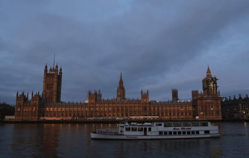 The Palace of Westminster viewed from the south side of the embankment by the River Thames just after dawn in London, Monday, Jan. 18, 2021. (AP Photo/Alastair Grant)