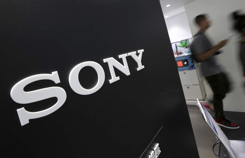 FILE - In this July 31, 2014, file photo, visitors walk past a logo of Sony at Sony Building in Tokyo. Profit at Japanese electronics and entertainment company Sony Corp. more than doubled in the last quarter on healthy gains in its video game sector, as people stayed home during the pandemic. (AP Photo/Eugene Hoshiko, File)