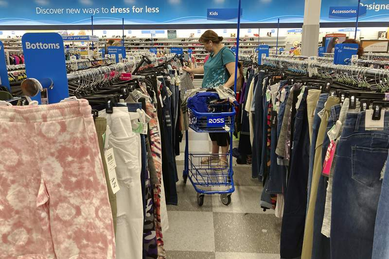 In this July 21,2021 photo, a consumer shops at a retail store in Morton Grove, Ill. U.S. consumer spending accelerated in August despite the surge in COVID cases, while the additional demand combined with supply shortages kept inflation high.  (AP Photo/Nam Y. Huh)