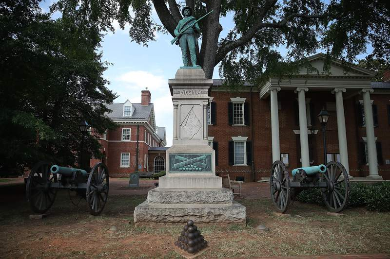 The statue of a Confederate soldier and two Civil War cannons stand in front of the Albemarle County Court House