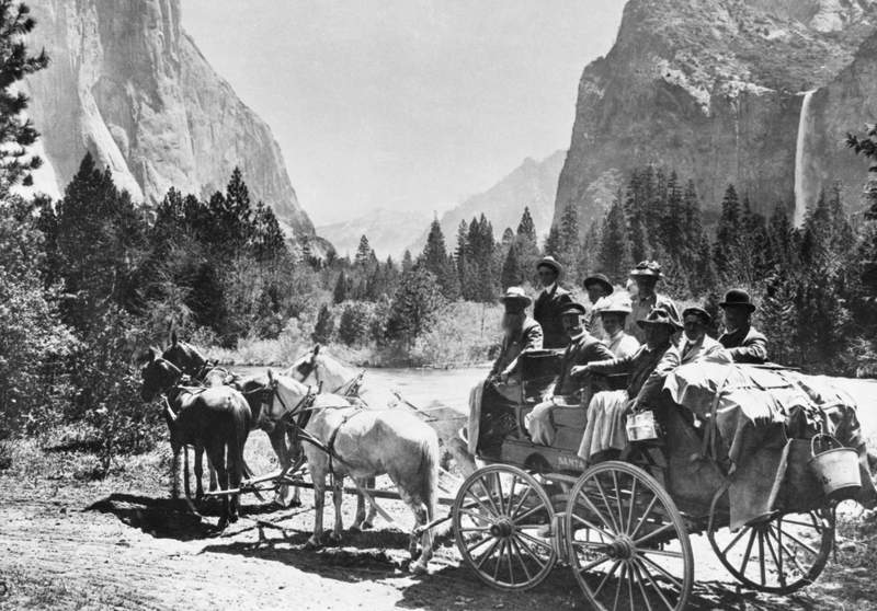 A Yosemite Park stagecoach with Bridalveil Fall in background. This is from the early 1900s.