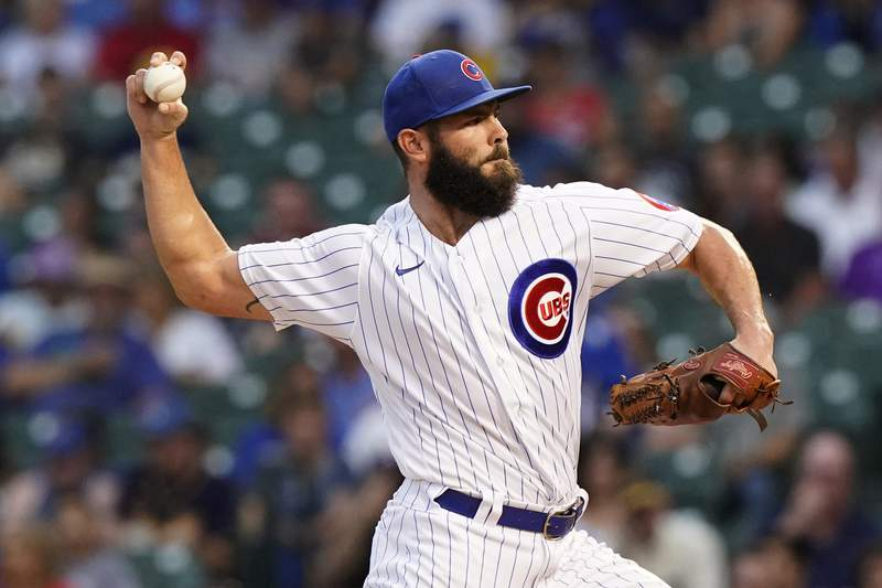 Chicago Cubs starting pitcher Jake Arrieta throws to a Milwaukee Brewers batter during the first inning of a baseball game in Chicago, Wednesday, Aug. 11, 2021. (AP Photo/Nam Y. Huh)