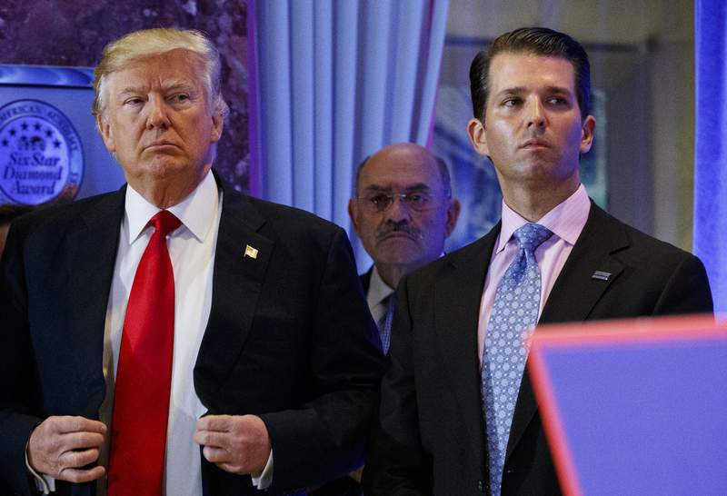 FILE - In this Jan. 11, 2017, shows President-elect Donald Trump, left, his chief financial officer Allen Weisselberg, center, and his son Donald Trump Jr., right, attend a news conference in the lobby of Trump Tower in New York. Manhattan prosecutors have informed Donald Trumps company that it could soon face criminal charges stemming from a long-running investigation into the former presidents business dealings. The New York Times reported that charges could be filed against the Trump Organization as early as next week related to fringe benefits the company gave to top executives, such as use of apartments. (AP Photo/Evan Vucci, File)