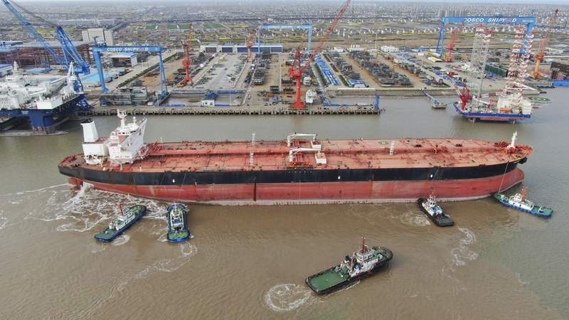 FILE - In this photo taken Monday, March 16, 2020, tugboats push a 300,000-ton very large crude carrier (VLCC) to a shipyard on the Yangtze River for retrofit in Qidong city in east China's Jiangsu province China. China, the worlds biggest energy consumer, is taking advantage of a plunge in global oil prices due to the coronavirus outbreak to build up its stockpiles of crude. Imports rose 4.5% in March over a year earlier even as the worlds second-largest economy shut down to fight the virus and demand collapsed. (Chinatopix Via AP, File)