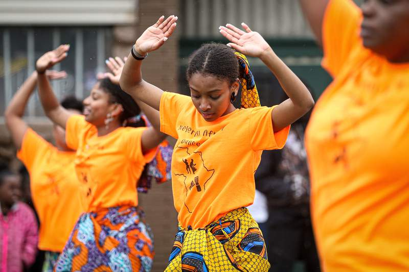 Members of the parade perform during the 48th Annual Juneteenth Day Festival on June 19, 2019 in Milwaukee.