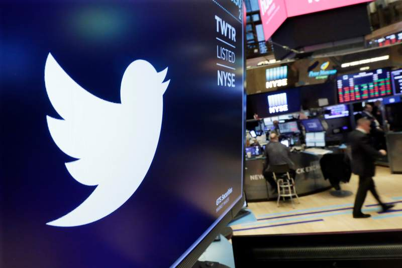 FILE - In this Feb. 8, 2018, file photo, the logo for Twitter is displayed above a trading post on the floor of the New York Stock Exchange.  Twitter is imposing new rules, Friday, Oct. 9, 2020,  ahead of the U.S. presidential election, prohibiting people,  including candidates, from claiming an election win before it is called by either state election officials or two authoritative, national news outlets. (AP Photo/Richard Drew, File)