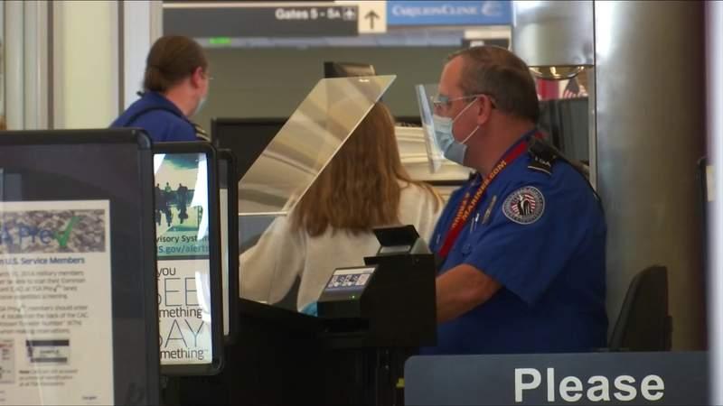 Airports seeing holiday travel rush despite CDC warnings