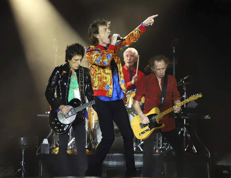 FILE - In this Aug. 5, 2019 file photo, Ronnie Wood, from left, Mick Jagger, Charlie Watts and Keith Richards of The Rolling Stones perform in East Rutherford, N.J. The Rolling Stones are celebrating the 40th anniversary of their album Tattoo You with a remastered collection that includes nine previously unreleased tracks. The newly-remastered 11-track album is out on Oct. 22. (Photo by Greg Allen/Invision/AP, File)