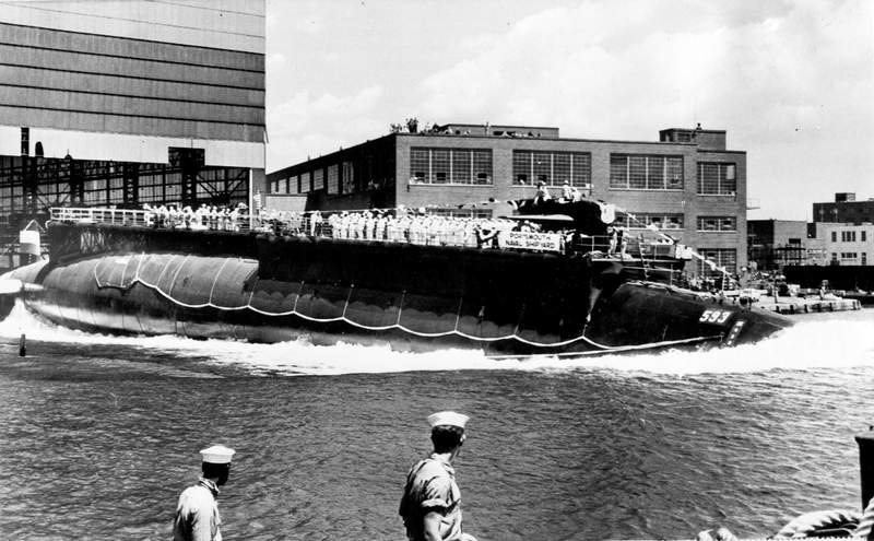 FILE - In this July 9, 1960 file photo the 278-foot (82 meters) long nuclear powered attack submarine USS Thresher, a first in its class boat, is launched bow-first at the Portsmouth Navy Yard in Kittery, Maine. The USS Thresher sank on April 10, 1963, killing all 129 crew on board, during an Atlantic Ocean test dive about 220 miles off the Massachusetts' coast. The release of about 3,000 pages of documents delving into the deadliest submarine disaster in U.S. history has not yielded any sinister effort to hide the truth, a retired Navy skipper says. (AP Photo/File)