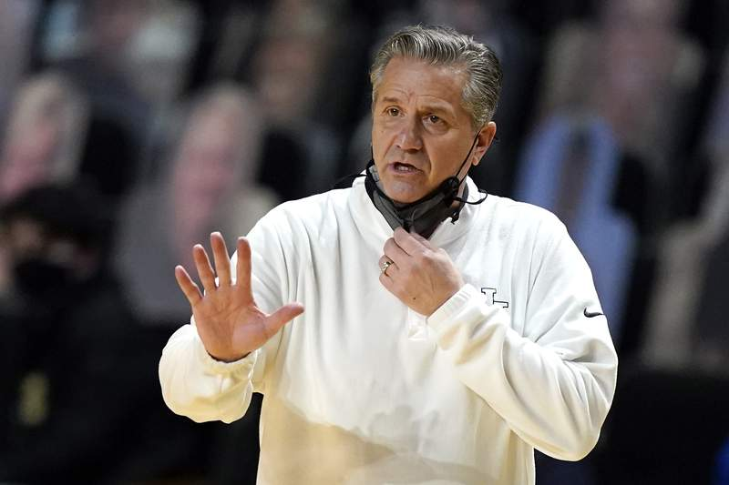 FILE - In this Feb. 17, 2021, file photo, Kentucky head coach John Calipari gestures during the first half of an NCAA college basketball game against Vanderbilt in Nashville, Tenn. Calipari is awaiting a pivotal rulings on the eligibility of transfers before he will know wholl be around to help the Wildcats bounce back from the coachs first losing season in Lexington. (AP Photo/Mark Humphrey, File)