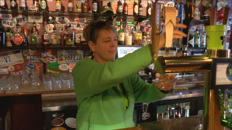 Jack Mason's Tavern co-owner Martha Atherholt pours a beer Tuesday afternoon.