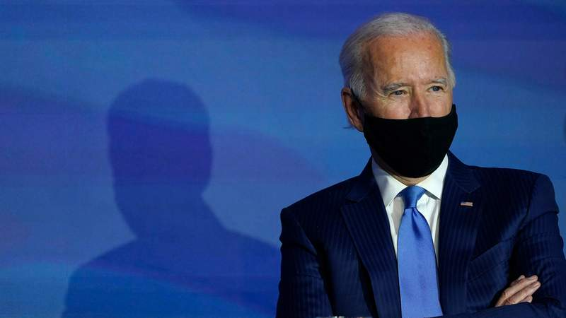 President-elect Joe Biden listens during an event to announce his choice for several positions in his administration at The Queen theater in Wilmington, Del., Friday, Dec. 11, 2020. (AP Photo/Susan Walsh)